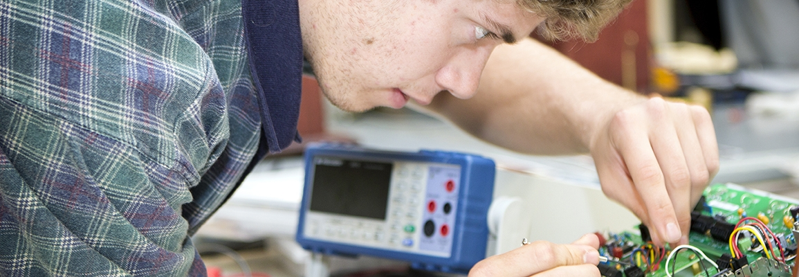 student working on a circuit board