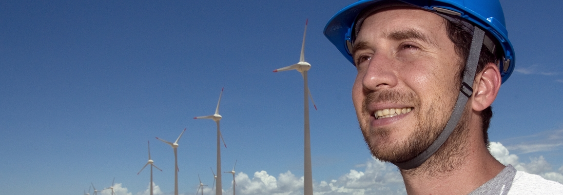 student working at a wind farm